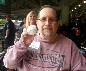 The proud winner of a baseball signed by Vinnie Pestano.