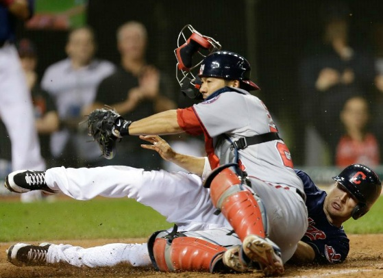 Drew Stubbs was just fast enough to slide ahead of the tag to give the Indians the win. (Photo Credit: Tony Dejak / Associated Press)