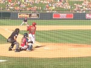 Andy Marte slapping a hit to the outfield.