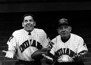 John Romano, left, and Indians manager Jimmie Dykes watch the rain fall before a spring training game, February 1961