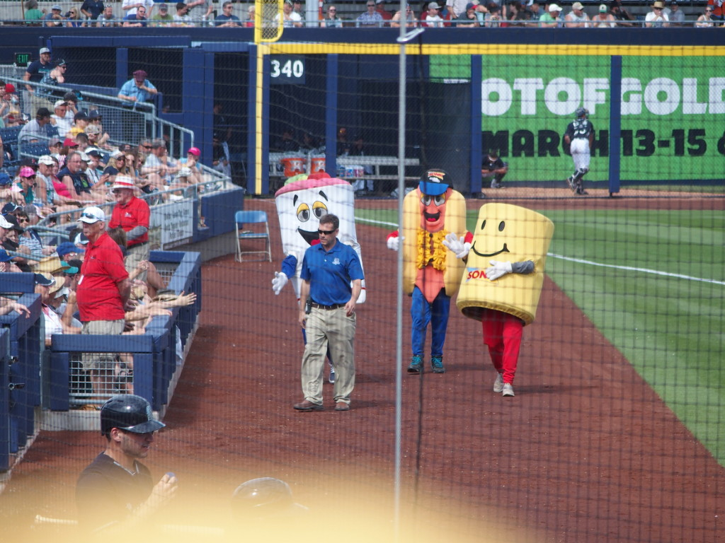 This is the end of a race between a hot dog, a cherry lime-aid, and a tater tot.