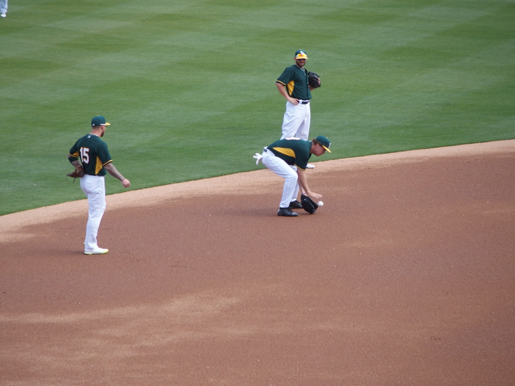 Will Farrell fields a ball at shortstop as an Oakland Athletic during the pre-game warm-up of their game with the Seattle Mariners on March 12
