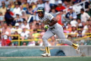CHICAGO, IL - CIRCA 1990: Outfielder Rickey Henderson #24 of the Oakland Athletics runs the bases against the Chicago White Sox during an Major League Baseball game circa 1990 at Comiskey Park in Chicago, Illinois. Henderson played for the Athletics from 1979-84, 1989-93,1994-95 and 1998. (Photo by Focus on Sport/Getty Images) *** Local Caption *** Rickey Henderson