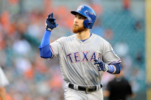 BALTIMORE, MD - AUGUST 04: Jonathan Lucroy #25 of the Texas Rangers celebrates after hitting a home run in the second inning against the Baltimore Orioles at Oriole Park at Camden Yards on August 4, 2016 in Baltimore, Maryland.  (Photo by Greg Fiume/Getty Images)