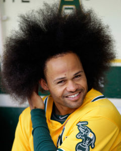 Oakland Athletics' Coco Crisp runs his fingers through his hair in the dugout prior to a baseball game against the Detroit Tigers, Thursday, April 14, 2011, in Oakland, Calif. (AP Photo/Ben Margot)